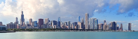 hancock building: Chicago skyline panorama with skyscrapers over Lake Michigan with cloudy blue sky