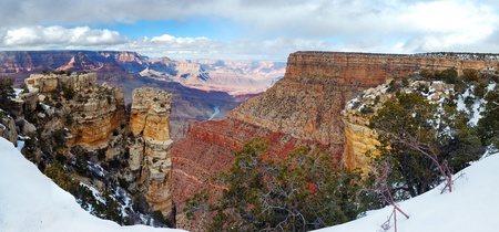 Grand Canyon panorama view in winter with snow and clear blue sky. photo