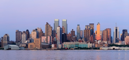 weehawken: New York City Manhattan sunset panorama with historical skyscrapers over Hudson River viewed from New Jersey Weehawken waterfront at dusk with tranquil blue tone.  Editorial