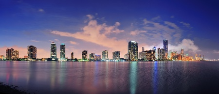 Miami city skyline panorama at dusk with urban skyscrapers over sea with reflection Stock Photo - 12989225