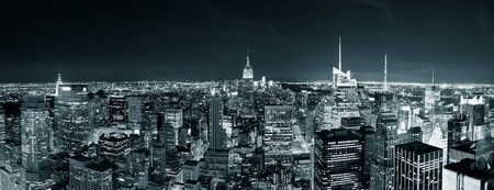 city by night: New York City Manhattan skyline at night panorama black and white with urban skyscrapers.