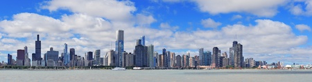 Chicago city urban skyline panorama with skyscrapers over Lake Michigan with cloudy blue sky. Stock Photo - 12987702