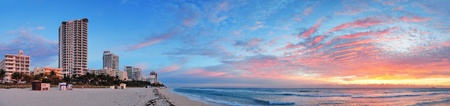 Miami South Beach sunrise panorama with hotels and colorful cloud and blue sky.