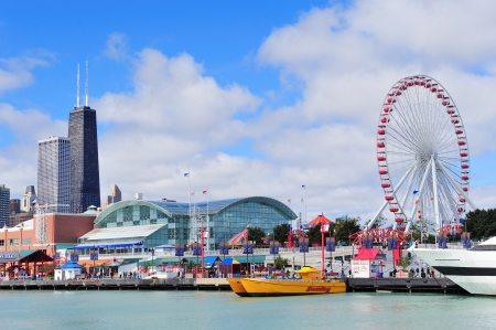 CHICAGO, IL - Oct 1: Navy Pier and skyline on October 1, 2011 in Chicago, Illinois. It was built in 1916 as 3300 foot pier for tour and excursion boats and is Chicagos number one tourist attraction.
