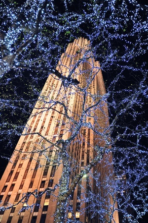 declared: NEW YORK CITY, NY, USA - DEC 30: Rockefeller Center at night on December 30, 2011, New York City. It was built by the Rockefeller family in 1939 and was declared a National Historic Landmark in 1987.
