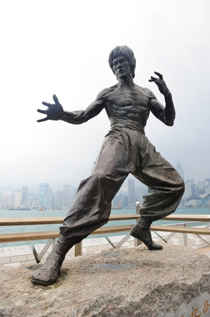 famous industries: HONG KONG, CHINA - APR 17: Bruce Lee Statue in Avenue of Stars on April 17, 2012 in Hong Kong, China. The promenade honours celebrities of the Hong Kong film industry as the famous city attraction.