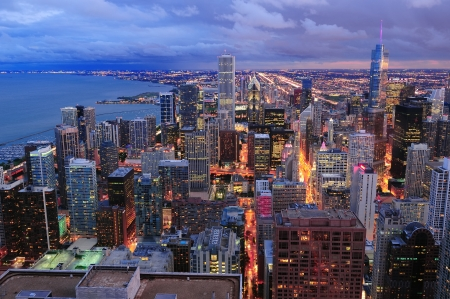 chicago skyline: Chicago skyline panorama aerial view with skyscrapers over Lake Michigan with cloudy  sky at dusk. Stock Photo