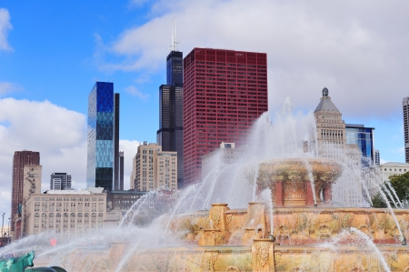 Chicago skyline panorama with skyscrapers and Buckingham fountain in Grant Park in the morning with cloud and blue sky. photo