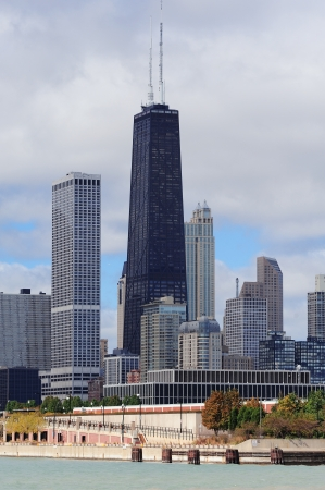 Chicago city urban skyline with skyscrapers over Lake Michigan with cloudy blue sky. Stock Photo - 14113674