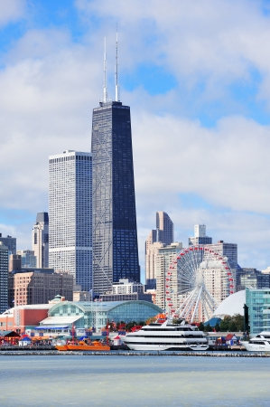 Chicago city urban skyline with skyscrapers over Lake Michigan with cloudy blue sky. Stock Photo - 14114734