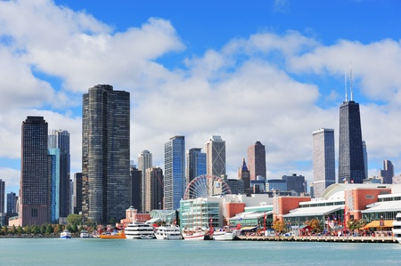 Chicago city downtown urban skyline with skyscrapers over Lake Michigan with cloudy blue sky. Stock Photo - 14115161