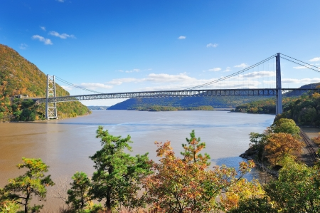 Bear Mountain with Hudson River and bridge in Autumn with colorful foliage and water reflection. photo