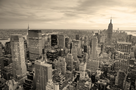 New York City skyline black and white with urban skyscrapers at sunset. photo