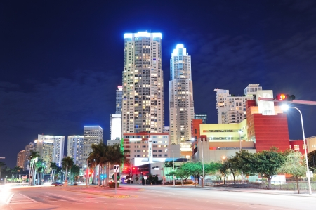 Miami downtown street view at night with hotels. photo