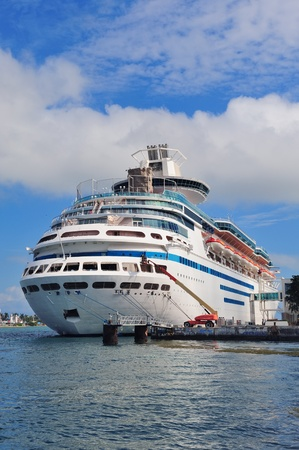 Cruise ship park at Miami dock with cloud and blue sky. photo