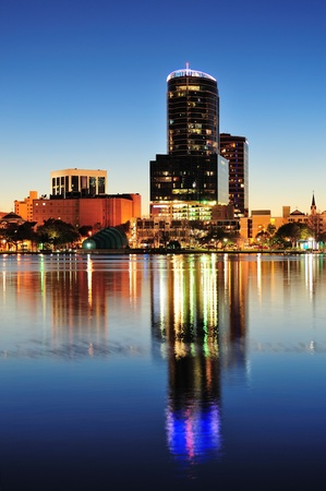 Orlando downtown skyline panorama over Lake Eola at night with urban skyscrapers and clear sky. photo