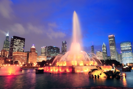 chicago skyline: Chicago skyline with skyscrapers and Buckingham fountain in Grant Park at dusk lit by colorful lights.