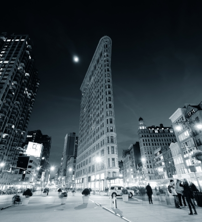 NEW YORK CITY, NY - DEC 30: Flatiron Building at night on March 30, 2011 in New York City. Flatiron building designed by Chicagos Daniel Burnham was designated a New York City landmark in 1966.