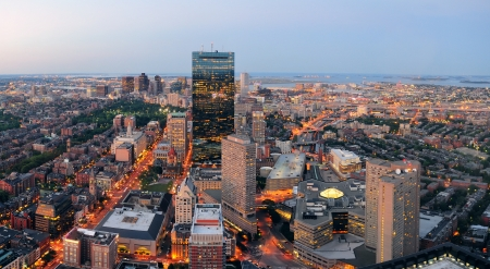 boston skyline: Urban city aerial view. Boston aerial view with skyscrapers at sunset with city downtown skyline.