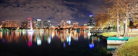Orlando Lake Eola panorama with office buildings at night photo