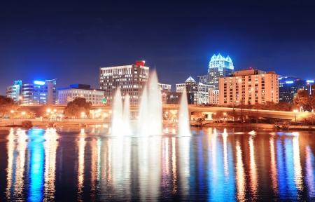 Orlando Lake Lucerne panorama at night with office buildings, bridge and fountain photo