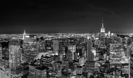 New York City Manhattan skyline at night panorama black and white with urban skyscrapers. photo