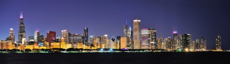 Chicago city downtown urban skyline panorama at dusk with skyscrapers over Lake Michigan with clear blue sky. Stock Photo - 14118033