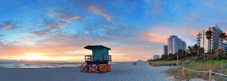 panoramic beach: Miami South Beach sunrise with hotels and coastline with colorful cloud and blue sky. Stock Photo