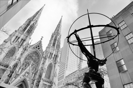 NEW YORK CITY, NY - DEC 30: Atlas statue and St. Patricks Cathedral on December 30, 2011 in New York City. Fifth Avenue has the worlds most expensive retail spaces as the symbol of wealthy New York.