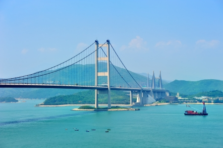 hong kong harbour: Tsing Ma Bridge in Hong Kong over sea in the day with blue sky