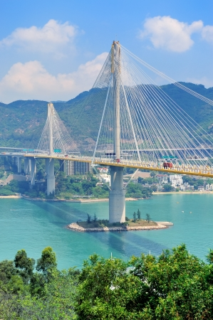 hong kong people: Ting Kau Bridge in Hong Kong over sea in the day with blue sky