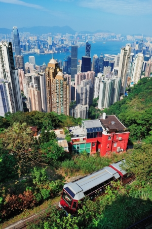 Urban architecture in Hong Kong in the day viewed from mountain top photo