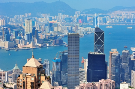 Hong Kong aerial view panorama with urban skyscrapers and sea.  photo