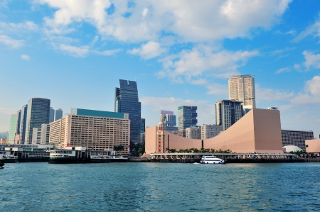 Urban architecture in Hong Kong Victoria Harbor in the day with blue sky and cloud. photo