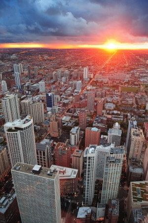 Chicago skyline panorama aerial view with skyscrapers and cloudy sky at sunset. photo