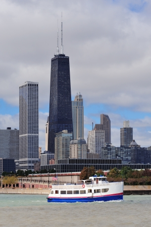 Chicago city urban skyline with skyscrapers over Lake Michigan with cloudy blue sky. photo