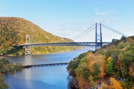 Bear Mountain with Hudson River and bridge in Autumn with colorful foliage and water reflection.
