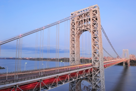 steel arch bridge: George Washington Bridge at sunset over Hudson River.