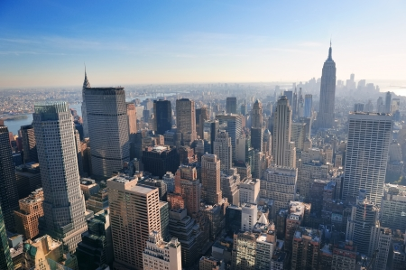 new york buildings: New York City skyline in midtown Manhattan aerial panorama view in the day. Stock Photo