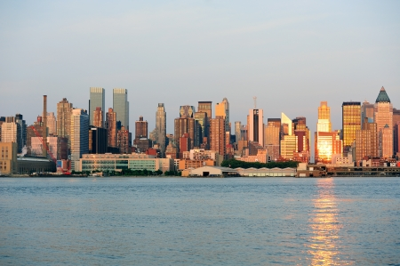 weehawken: New York City Manhattan midtown skyline at sunset with reflection over skyscraper and river. Stock Photo