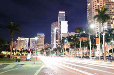 miami: Miami downtown street view at night with hotels.