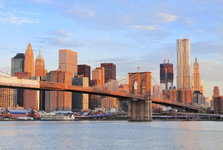 manhattan bridge: Brooklyn Bridge with lower Manhattan skyline in the morning with colorful cloud over East River in New York City