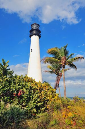 Cape Florida Light lighthouse with Atlantic Ocean and palm tree at beach in Miami with blue sky and cloud. Stock Photo - 14360343
