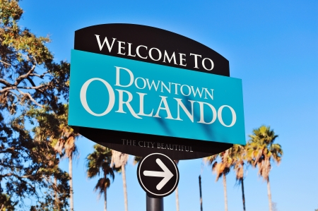 orlando: Orlando downtown welcome sign with tropical scene Stock Photo