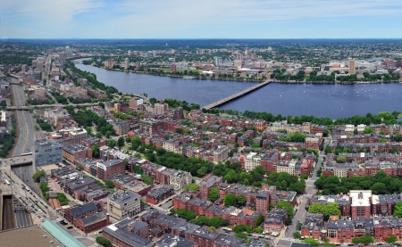 Charles River aerial view panorama with Boston midtown city skyline and Cambridge district