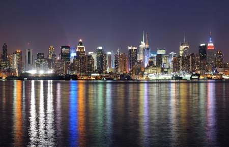 city square: New York City Manhattan midtown skyline at night with lights reflection over Hudson River viewed from New Jersey Weehawken waterfront  Stock Photo