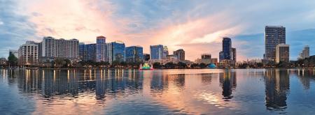 orlando: Orlando downtown Lake Eola panorama with urban buildings and reflection Stock Photo