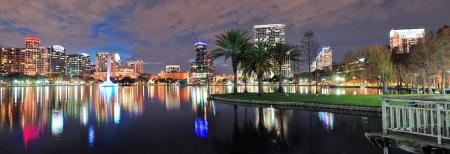 orlando: Orlando Lake Eola panorama with office buildings at night Stock Photo