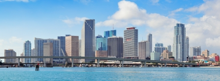 city of miami: Miami skyscrapers with bridge over sea in the day  Stock Photo