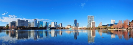 lake district: Orlando Lake Eola in the morning with urban skyscrapers and clear blue sky